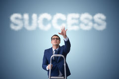 The businessman reaching success with career ladder Stock Photography