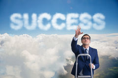 The businessman reaching success with career ladder Stock Photos