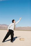 Businessman reaching up Royalty Free Stock Photo