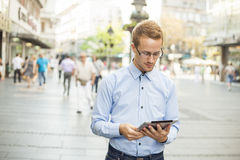 Businessman read news on Tablet Computer Royalty Free Stock Photo