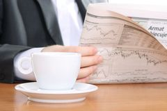 Businessman read newspaper Stock Images