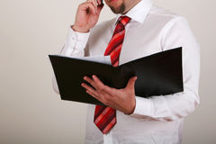 Businessman reading Royalty Free Stock Image