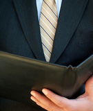 Businessman reading. Businessman holding a folder stock photography