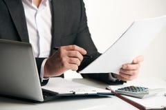 Businessman reading agreement documents stock photo
