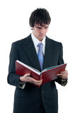 Businessman reading the big red book Stock Photo