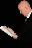 Businessman reading on black Stock Photo