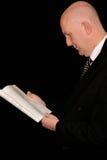 Businessman reading on black Stock Photo