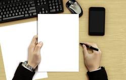 Businessman reading blank document Royalty Free Stock Photo