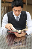 Businessman reading a book. At cafe Royalty Free Stock Photo