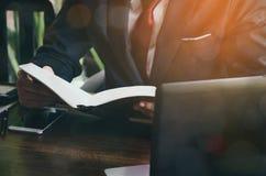 Businessman reading book. Stock Photo