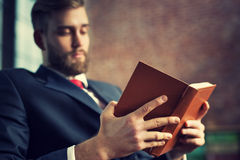 Businessman reading book Royalty Free Stock Photos