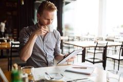 Businessman reading on break. Businessman working while taking a break, no time to waste Stock Photos