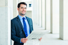 Businessman reading  business newspaper Royalty Free Stock Photos