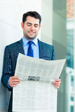 Businessman reading  business newspaper Stock Images