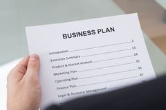 Businessman reading business plan Royalty Free Stock Photos