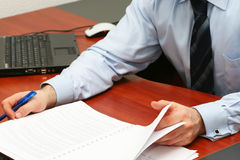 Businessman reading contract. In the office Royalty Free Stock Image