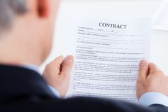 Businessman reading the contract form Stock Photography
