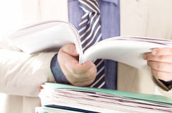 Businessman reading contracts Stock Photos
