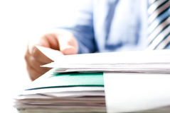 Businessman reading contracts. Small DOF Royalty Free Stock Photo