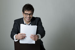 Businessman reading document Royalty Free Stock Photo
