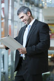 Businessman reading document Stock Images