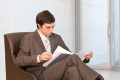 Businessman reading document Stock Photography
