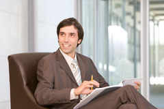 Businessman reading document Royalty Free Stock Photos