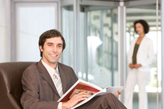 Businessman reading document Stock Image