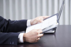 Businessman reading a document Stock Photography