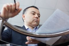 Businessman reading document Royalty Free Stock Image