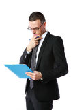 Businessman reading document Stock Photos