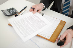 Businessman reading a document Stock Image