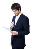 Businessman reading document Royalty Free Stock Images
