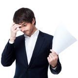 Businessman reading document Royalty Free Stock Photo
