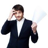 Businessman reading document Stock Photos