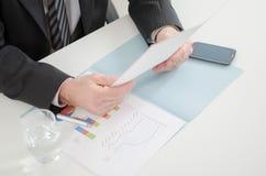 Businessman reading a document Stock Photo