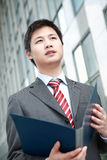Businessman  is reading document outdoor Stock Photo