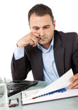 Businessman reading documents Royalty Free Stock Photography