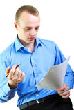 Businessman reading documents. The businessman reads financial documents stock photo
