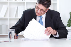 Businessman reading documents Stock Images