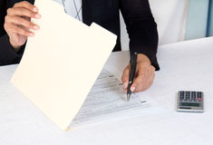 Businessman reading documents. Corporate employee working of company accounts Stock Images