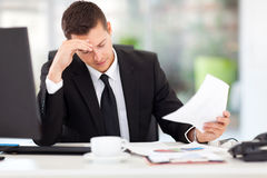 Businessman reading documents Royalty Free Stock Photos