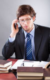 Businessman reading documents and talking Royalty Free Stock Photos