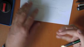 Businessman reading documents, then signing them and put stamp stock video