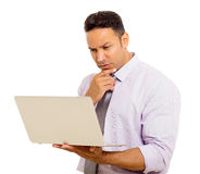 Businessman reading email. Handsome mid age businessman reading email on his laptop Royalty Free Stock Images