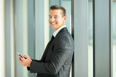 Businessman reading email. Smiling businessman reading email on smart phone Royalty Free Stock Images