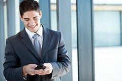 Businessman reading emails Stock Image