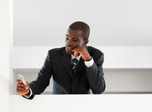 Businessman reading emails stock photo