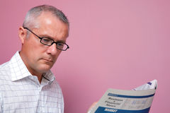 Businessman reading the financial newspaper Stock Photos