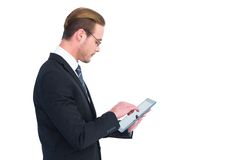 Businessman in reading glasses using his tablet pc Royalty Free Stock Photography